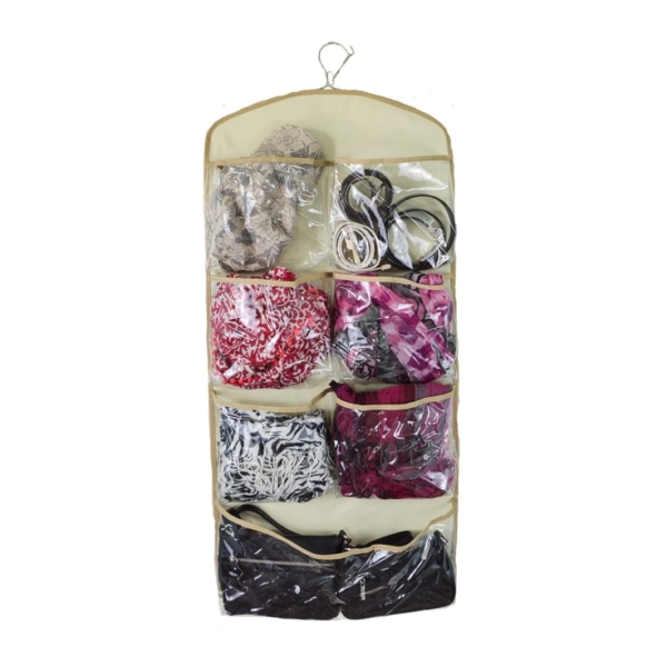 The back side of a hanging pocket organizer filled with scarves, purses, hats and other fashion accessories