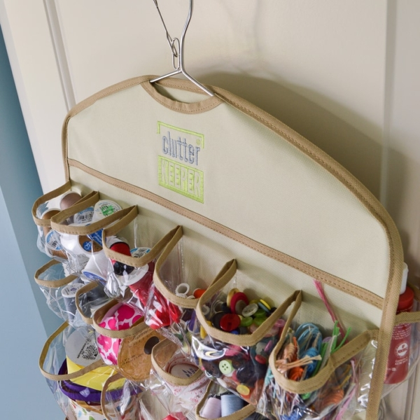Close up of the smaller pockets filled with craft supplies at the top of the 44 Pocket Hanging Organizer from Clutter Keeper®