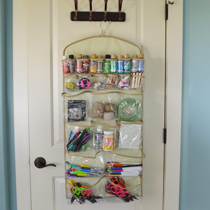 Pockets of a hanging organizer are filled with craft supplies to help you keep your closet organized.