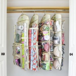 Four Clutter Keeper hanging organizers on a rod in a closet