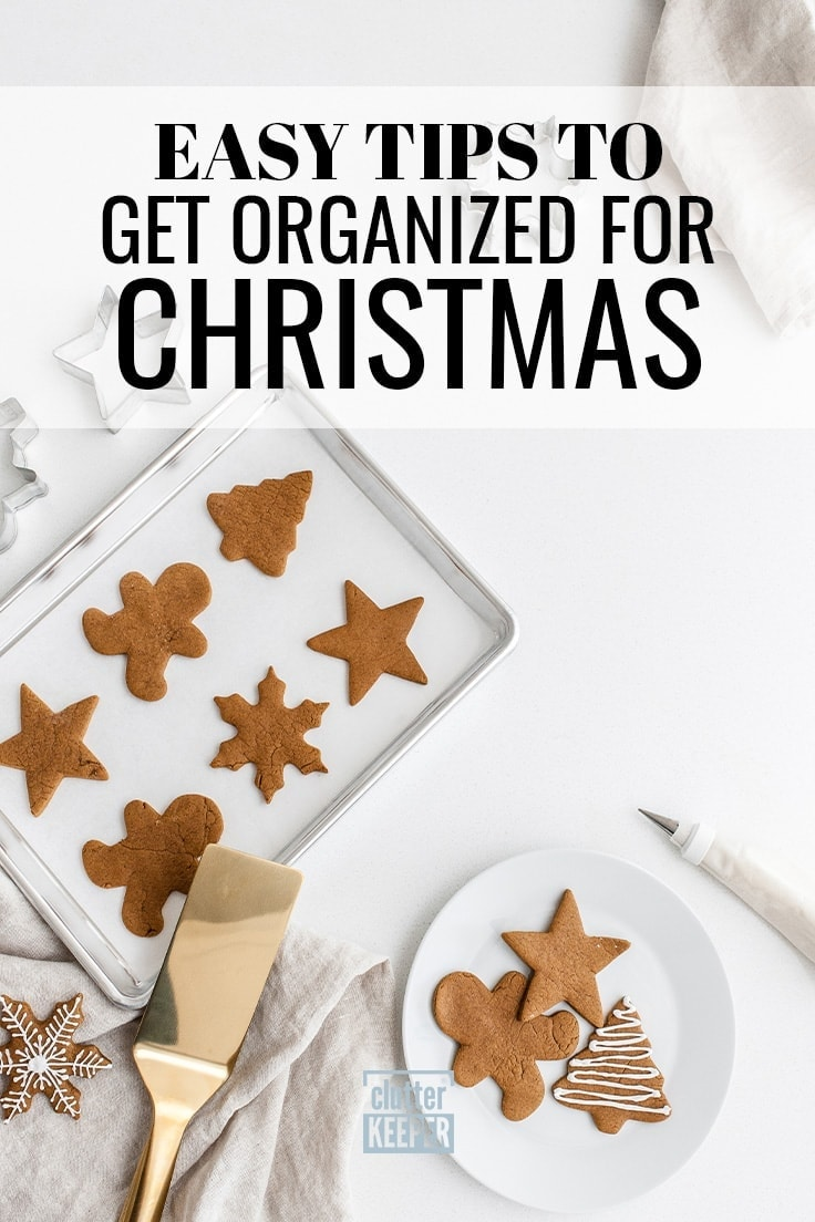 Easy Tips to Get Organized for Christmas, overhead shot of Christmas cookies on a baking sheet as well as a plate of cookies being decorated for the holidays