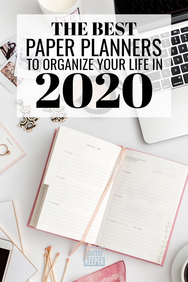 The best paper planners to organize your life in 2020, A paper planner on a desk top next to an open lap top computer and an iPhone