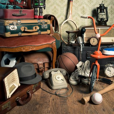 antiques, sporting equipment and vintage home decor being stored in an attic