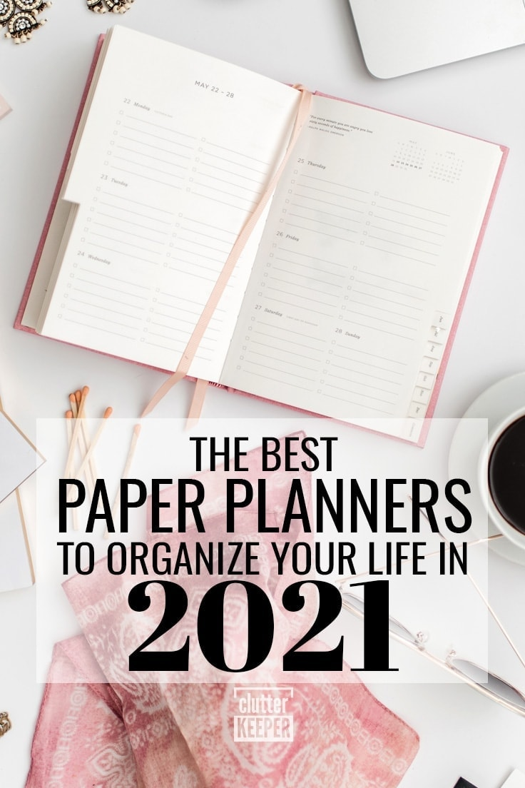 The best paper planners to organize your life in 2021, A paper planner on a desk top next to an open lap top computer and an iPhone