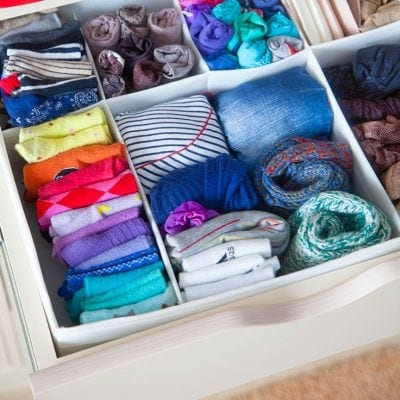 Folded clothes in a dresser drawer