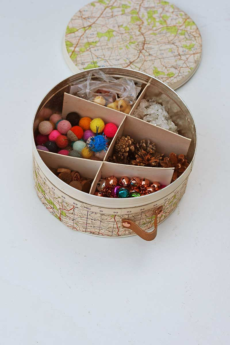How to create an organizer for small craft supplies out of a cookie tin.