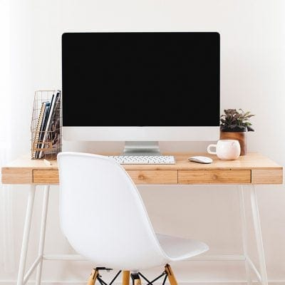 Modern desk in a home office with an Apple computer