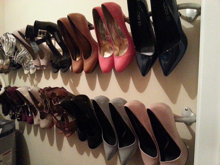 Shoes hanging up on the wall of a closet